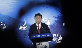 Chinese President Xi Jinping delivers his keynote address at the Asia-Pacific Economic Cooperation summit in Bali, Indonesia, on Monday, Oct. 7, 2013. (AP Photo/Wong Maye-E)