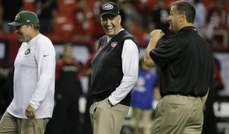 New York Jets head coach Rex Ryan walks on the field before the first half of an NFL football game against the Atlanta Falcons, Monday, Oct. 7, 2013, in Atlanta. (AP Photo/David Goldman)