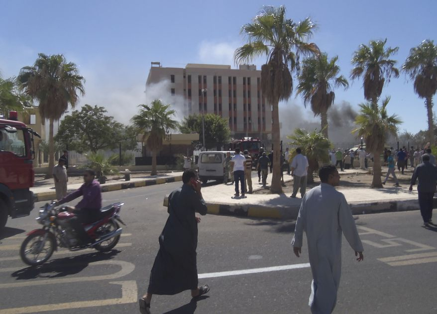 Smoke rises from a security headquarters building in the southern Sinai town of el-Tor, Egypt, after a car bombing there on Monday, Oct. 7, 2013. Monday's attack, which killed several people and wounded dozens, came a day after at least 51 people died in clashes between security forces and supporters of ousted President Mohammed Morsi across much of Egypt. (AP Photo)