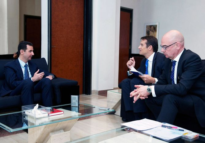 Syrian President Bashar Assad (left) speaks during an interview with the German magazine Der Spiegel in Damascus, Syria, on Monday, Oct. 7, 2013. (AP Photo/SANA)