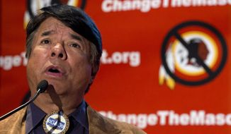 "Ray Halbritter, National Representative of the Oneida Indian Nation, speaks during the Oneida Indian Nation's Change the Mascot symposium, Monday, Oct. 7, 2013, in Washington, calling for the Washington Redskins NFL football team to change its name. President Barack Obama suggested that the owner of the Washington Redskins football team consider changing its name because, the president said, the current name offends ""a sizable group of people."" (AP Photo/Carolyn Kaster)"