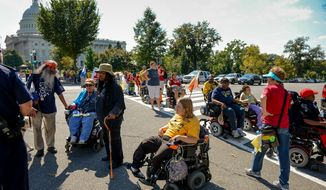 ** FILE ** Disability rights activists with ADAPT are turned away from the U.S. Capitol Building as they try to deliver a letter to Congress demanding the end to the government shutdown, Washington, D.C., Wednesday, Oct. 2, 2013. (Andrew Harnik/The Washington Times)