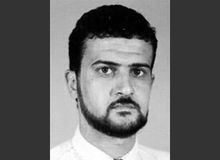 """FILE - This file image from the FBI website shows Abu Anas al-Libi, an al-Qaeda leader connected to the 1998 embassy bombings in eastern Africa and wanted by the United States for more than a decade. Al-Libi was captured in a raid Saturday, Oct. 5, 2013, and is being held aboard the USS San Antonio, a warship mainly used to transport troops. Instead of sending suspected terrorists to Guantanamo Bay or secret CIA """"black"""" sites for interrogation, the Obama administration is questioning them aboard U.S. naval vessels. (AP Photo/FBI, File)"""
