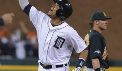 Detroit Tigers designated hitter Victor Martinez looks skyward after hitting a solo home run during the seventh inning of Game 4 of baseball's American League division series against the Oakland Athletics in Detroit, Tuesday, Oct. 8, 2013. (AP Photo/Lon Horwedel)