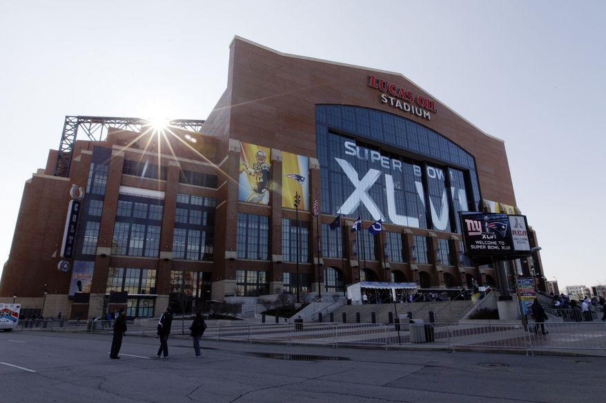 **FILE** The exterior of Lucas Oil Stadium is seen before the NFL Super Bowl XLVI football game is held Sunday, Feb. 5, 2012, in Indianapolis. (AP Photo/Pat Semansky)