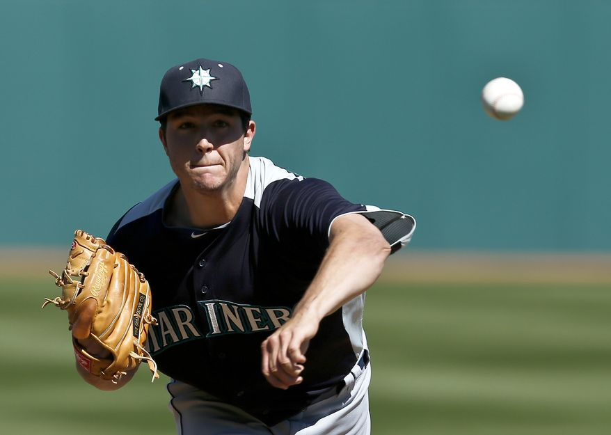 Seattle Mariners' Danny Hultzen throws a warmup pitch before an exhibition spring training baseball game against the Cleveland Indians, Wednesday, Feb. 27, 2013, in Goodyear, Ariz. The Mariners won 5-1. (AP Photo/Ross D. Franklin)