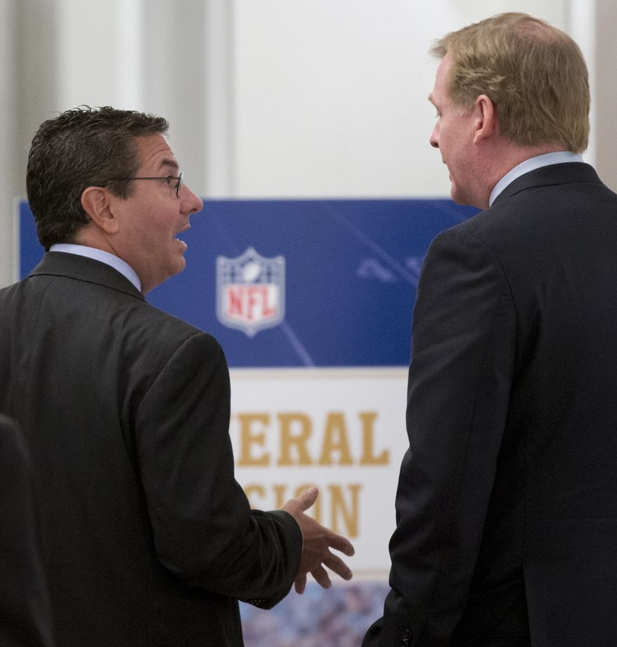 Washington Redskins football team owner Daniel Snyder, left, and NFL Commissioner Roger Goodell, right, talks during a break in the NFL fall meeting in Washington, Tuesday, Oct. 8, 2013. NFL owners hold their annual fall meeting, with discussions about the upcoming outdoor Super Bowl in New Jersey and player safety initiatives on the agenda.  (AP Photo/Carolyn Kaster)