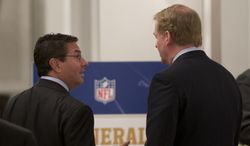 Washington Redskins football team owner Daniel Snyder, left, and NFL Commissioner Roger Goodell, talk during a break in the NFL fall meeting in Washington, Tuesday, Oct. 8, 2013. NFL owners hold their annual fall meeting, with discussions about the upcoming outdoor Super Bowl in New Jersey and player safety initiatives on the agenda.  (AP Photo/Carolyn Kaster)
