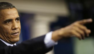 **FILE** President Barack Obama points to a member of the media as he speaks about the the budget and the partial government shutdown on Oct. 8, 2013, in the Brady Press Room of the White House in Washington. (Associated Press)