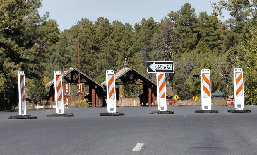 The Grand Canyon National Park entrance is blocked off on Tuesday, Oct. 8, 2013, in Tusayan, Ariz. The Grand Canyon remains closed to visitors because of the partial government shutdown. (AP Photo/Matt York)