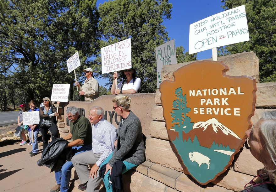 Government shutdown protesters gather at the Grand Canyon National Park entrance, Tuesday, Oct. 8, 2013, in Tusayan, Ariz. The Grand Canyon remains closed to visitors because of the partial government shutdown. (AP Photo/Matt York)