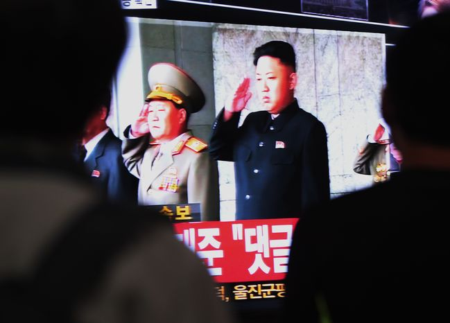 South Koreans at Seoul Station in Seoul watch a television broadcasting an image of North Korean leader Kim Jong-un (right) on Tuesday, Oct. 8, 2013. South Korea's spy agency told lawmakers that North Korea has restarted a plutonium reactor at its main nuclear facility, according to two parliamentary members who attended the closed-door briefing. (AP Photo/Ahn Young-joon)