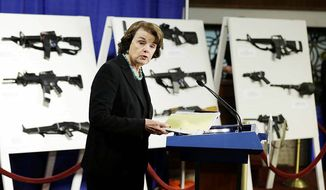 "Senator Diane Feinstein during a January 24 Capitol Hill press conference introducing legislation to ban so-called ""assault weapons."" Actual firearms are displayed behind her.      Associated Press photo"