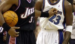 Washington Wizards' Michael Jordan (23) gets a shove by Utah Jazz's Karl Malone, left, during the third quarter of the Wizards' 105-102 win, Thursday, Nov. 14, 2002, at the MCI Center in Washington. (AP Photo/Nick Wass)