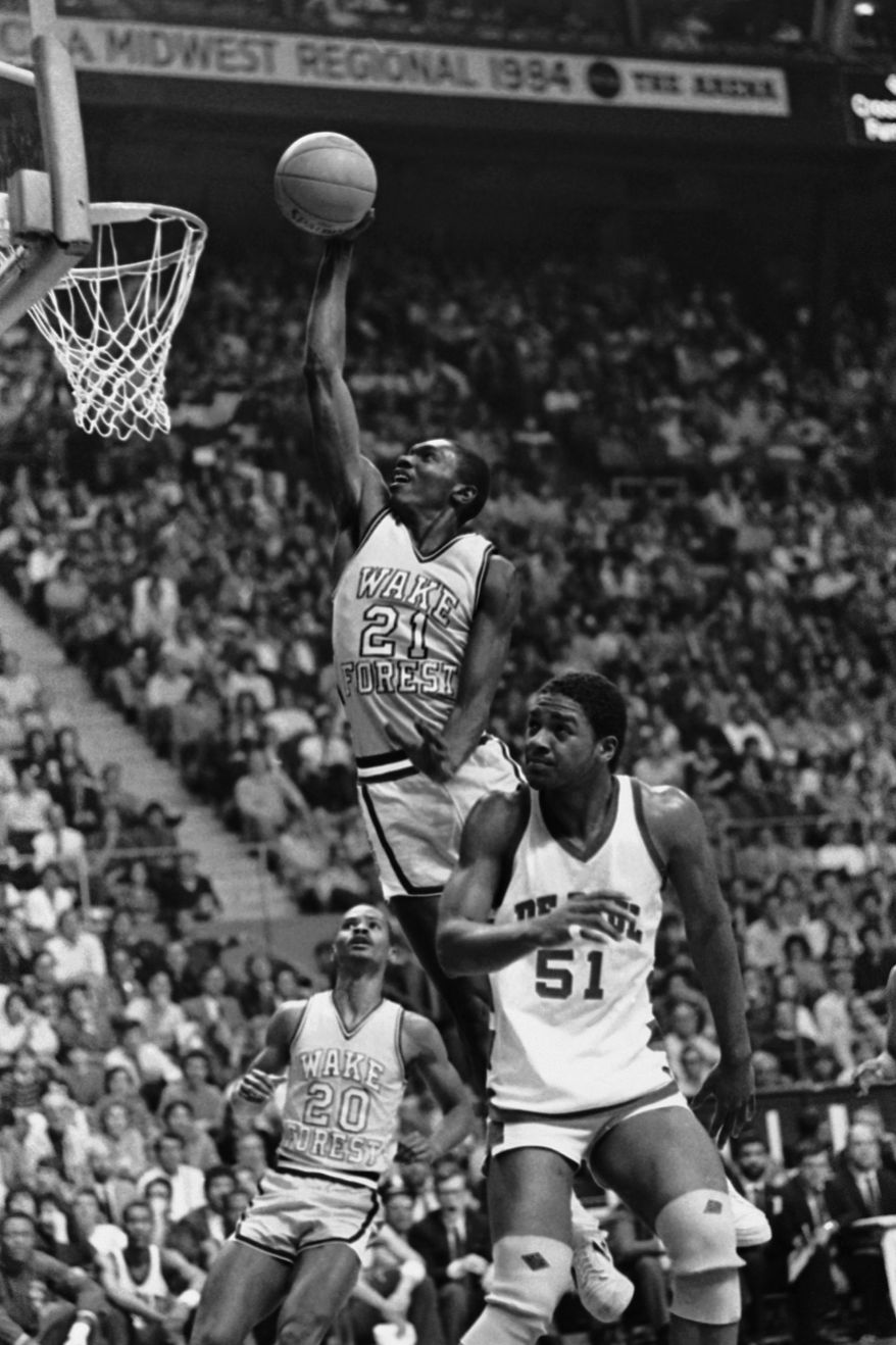 **FILE** Forward Kenny Green (21) of Wake Forest drives to the basket in the Deacons NCAA Midwest Regional Semifinal game against DePaul, March 23, 1984, St. Louis, Mo. In the foreground is Blue Demon center Marty Embry. (AP Photo)