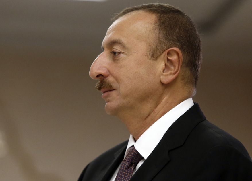 Azerbaijan President Ilham Aliyev seen  during the voting at a polling station in Baku, Azerbaijan, Wednesday, Oct. 9, 2013. Oil-rich Azerbaijan is booming and the wealth is trickling down to its poorest people. It all means that its president doesn't even need to clamp down too hard to ensure he extends a decades-long dynastic rule in elections on Wednesday. (AP Photo/Sergei Grits)
