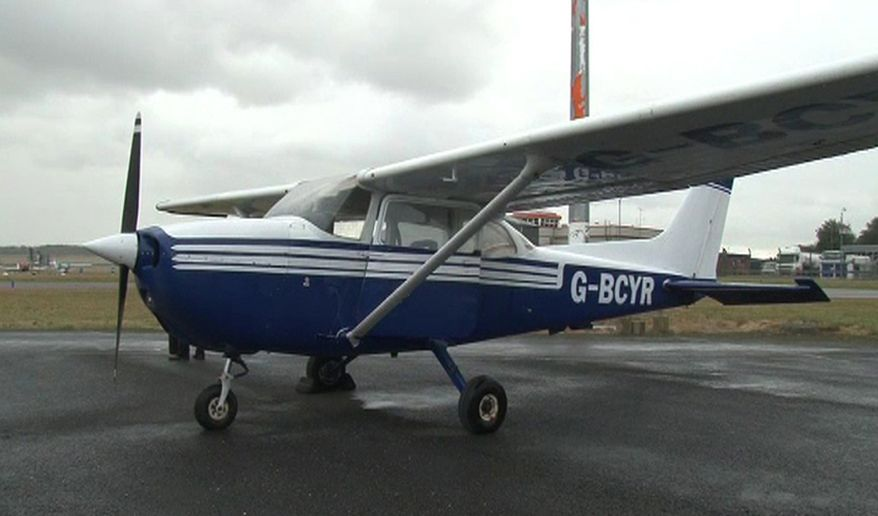 The Cessna 172 light aircraft that a passenger with no flying experience landed safely at Humberside Airport near Grimsby, England, after the pilot was taken ill on Tuesday, Oct. 8, 2013, is pictured on Thursday. The man landed the plane in the dark without lights with the aid of ground instructors. The pilot later was pronounced dead. (AP Photo/ Richard McCarthy, Press Association)