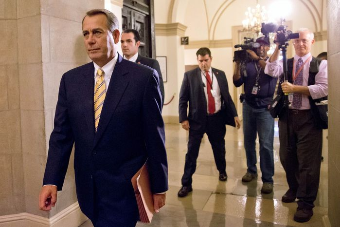 House Speaker John Boehner of Ohio arrives on Capitol Hill in Washington, Wednesday, Oct. 9, 2013. President Barack Obama is pressuring Boehner to hold votes to avoid a potentially catastrophic default and re-open the federal government, as a new poll indicated Republicans could
