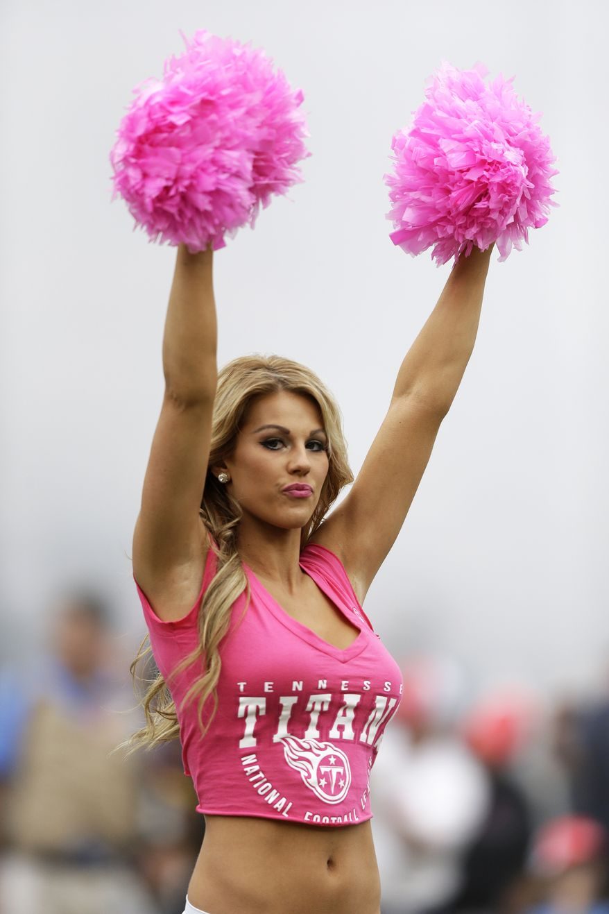 A Tennessee Titans cheerleader wears pink for breast cancer awareness before an NFL football game on Sunday, Oct. 6, 2013, in Nashville, Tenn. (AP Photo/Wade Payne)