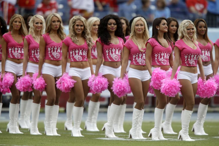 Tennessee Titans cheerleaders wear pink for breast cancer awareness before an NFL football game between the Titans and the Kansas City Chiefs on Sunday, Oct. 6, 2013, in Nashville, Tenn. (AP Photo/Wade Payne)