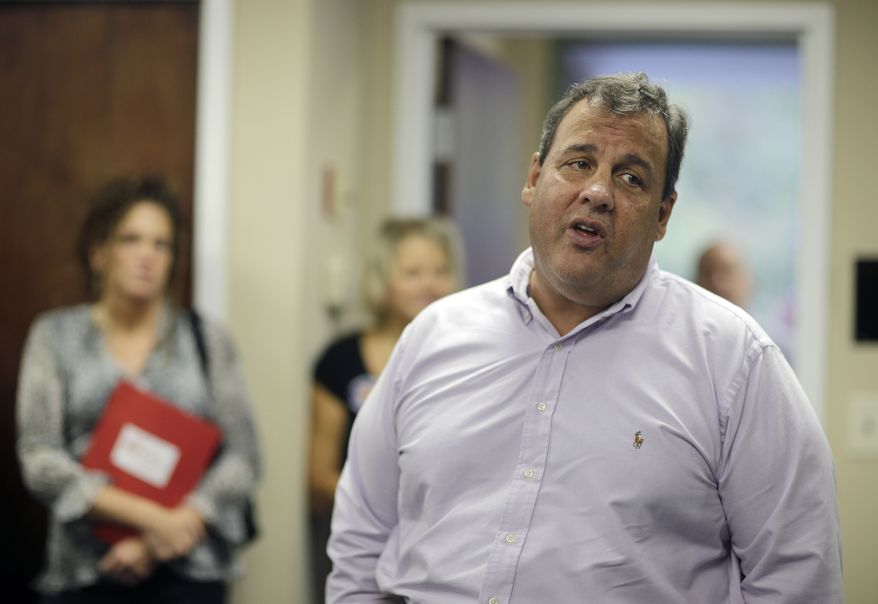 New Jersey Gov. Chris Christie addresses some campaign workers in East Brunswick, N.J., Tuesday, Oct. 8, 2013. Asked Tuesday why voters should give him another term, Christie said he's been honest about the state's problems and worked with Democrats to find bipartisan solutions. (AP Photo/Mel Evans)