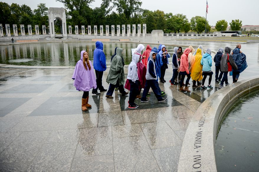 Students from Barnhart School in Arcadia, Calif. visit the World War II Memorial on the National Mall though the memorials are technically closed due to an ongoing government shutdown, Washington, D.C., Wednesday, October 9, 2013. (Andrew Harnik/The Washington Times)