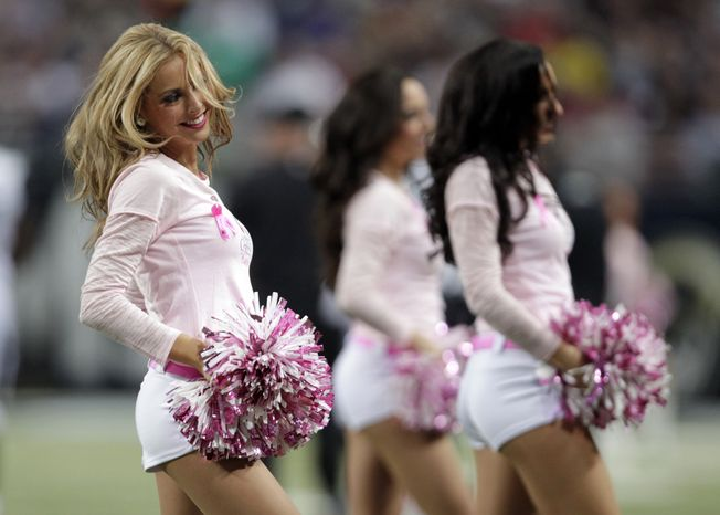 St. Louis Rams cheerleaders perform wearing pink in honor of breast cancer awareness during the second quarter of an NFL football game between the St. Louis Rams and the Jacksonville Jaguars Sunday, Oct. 6, 2013, in St. Louis. (AP Photo/Tom Gannam)