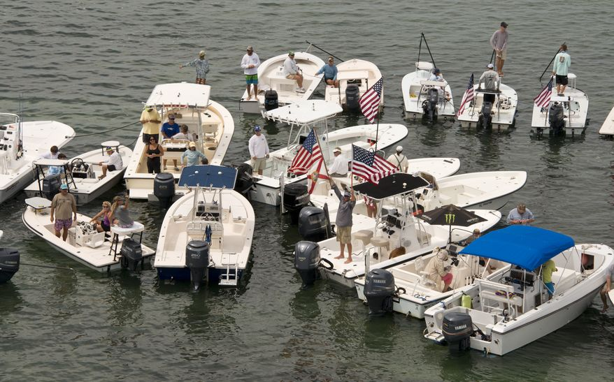 In this aerial photo provided by the Florida Keys News Bureau, participants aboard a portion of the 100 boats protesting  the closure of Everglades National Park waters is seen  Wednesday, Oct. 9, 2013, near Islamorada, Fla. About a third of the 2,380-square-mile park encompasses Florida Bay and it has been closed to Florida Keys guides and recreational fishermen since Oct. 1 due to the Washington budget impasse. Guides have lost business and are insisting that federal officials do something to let them back in. (AP Photo/Florida Keys News Bureau, Andy Newman)