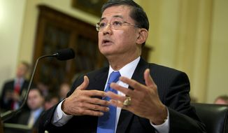 Veterans Affairs Secretary Eric Shinseki testifies on Capitol Hill in Washington, Wednesday, Oct. 9, 2013, before the House Veterans Affairs Committee hearing on the effects the government shutdown is having on benefits and services to veterans. About 3.8 million veterans will not receive disability compensation next month if the partial government shutdown continues into late October, Shinseki told lawmakers Wednesday. Some 315,000 veterans and 202,000 surviving spouses and dependents will see pension payments stopped.  (AP Photo/ Evan Vucci)