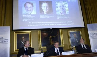 Chairman Sven Lidin, left, permanent secretary Staffan Normark, center, and professor Gunnar Karlstrom of the Royal Swedish Academy of Sciences announce the laureates Martin Karplus, Michael Levitt and Arieh Warshe as winners of the 2013 Nobel Prize in chemistry, during a press conference at the Royal Swedish Academy of Sciences in Stockholm, Sweden, Wednesday Oct. 9, 2013. (AP Photo/Claudio Bresician, TT News Agency) SWEDEN OUT