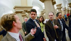 Rep. Paul Ryan, Wisconsin Republican, speaks with reporters as he leaves a news conference with House Republicans at the Capitol on Thursday. The government shutdown has moved things back into the wheelhouse of Mr. Ryan. (Andrew Harnik/The Washington Times)