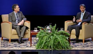 The Republican gubernatorial candidate, Virginia Attorney General Kenneth T Cuccinelli II (right), answers a question from University of Richmond President Edward L. Ayers during a forum at the university on Thursday. Recent polls have shown Democrat Terry McAuliffe leading. (Associated Press)