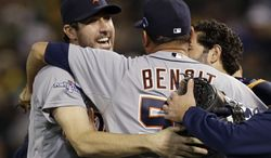 Detroit Tigers pitcher Joaquin Benoit (53) is congratulated by starting pitcher Justin Verlander, left, after the Tigers beat the Oakland Athletics 3-0 to win Game 5 of an American League baseball division series in Oakland, Calif., Thursday, Oct. 10, 2013. (AP Photo/Marcio Jose Sanchez)