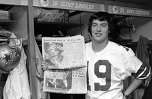 Clint Longley, Dallas Cowboys rookie quarterback, holds two of the local newspapers proclaiming his outstanding play in the Cowboys 24-23 victory over the Washington Redskins on Thursday, shown in Dallas, Texas on Nov. 29, 1974. Longley came in the third quarter after Roger Staubach was injured and guided the team from a 16-3 deficit to a last second victory with a 50-yard touchdown pass. (AP Photo/Harold Waters)