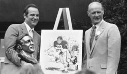 Longtime New York Giants and Washington Redskins linebacker Sam Huff, left, poses with his Pro Football Hall of Fame presenter and former coach Tom Landry following his Pro Football Hall of Fame enshrinement speech in Canton, Ohio on Aug. 7, 1982. (AP Photo/Amy Sancetta)