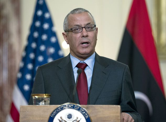** FILE ** In this March 13, 2013, file photo, Libyan Prime Minister Ali Zidan speaks during a joint news conference with U.S. Secretary of State John Kerry at the State Department in Washington. A government official says Libyan Prime Minister Ali Zeidan was kidnapped by gunmen early Thursday morning, Oct. 10, 2013, from a hotel in Tripoli where he resides. (AP Photo/Jose Luis Magana, File)