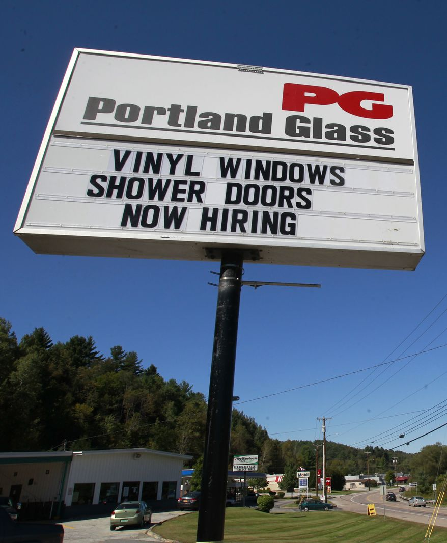 A Berlin, Vt., glass company advertises for workers on its outdoor sign on Wednesday, Sept. 18, 2013. (AP Photo/Toby Talbot)