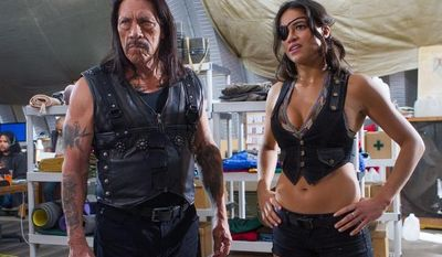 "Danny Trejo and Michelle Rodriguez star ""Machete Kills,"" the latest installment of the franchise. The film offers frequent bursts of comic violence to moviegoers thirsting for blood. (Open Road Films via Associated Press)"