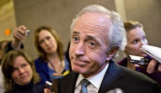 ** FILE ** Sen. Bob Corker, R-Tenn., shrugs as he talks to reporters about a two-hour meeting at the White House that he and other Senate Republicans had with President Barack Obama, trying to come up with a bipartisan solution to the budget stalemate, Friday, Oct. 11, 2013, on Capitol Hill in Washington. (AP Photo/J. Scott Applewhite)