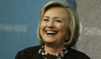 Former U.S. Secretary of State Hillary Clinton laughs as she arrives for an event at Chatham House in London, Friday, Oct. 11, 2013. (Associated Press) ** FILE **