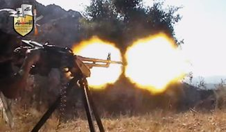 ** FILE ** In this file image taken from Sunday, Aug. 11, 2013, video obtained from the Shaam News Network, which has been authenticated based on its contents and other AP reporting, a rebel fighter fires a gun in a valley in an unidentified location in Latakia province, Syria. (AP Photo/Shaam News Network via AP Video, File)