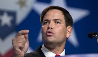 Sen. Marco Rubio, Florida Republican, gestures as he speaks at the Values Voter Summit, sponsored by the Family Research Council Action, on Friday, Oct. 11, 2013, in Washington. (AP Photo/Jose Luis Magana)