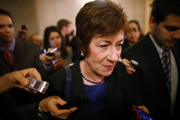 Sen. Susan Collins, R-Maine, is followed by reporters as she leaves a meeting of Senate Republicans regarding the government shutdown and debt ceiling on Capitol Hill in Washington