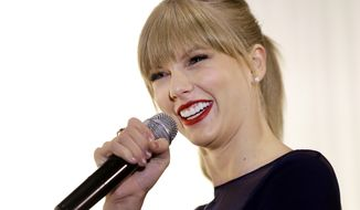 Taylor Swift speaks at the Country Music Hall of Fame and Museum on Saturday, Oct. 12, 2013, in Nashville, Tenn. Swift is at the facility to open the $4 million Taylor Swift Education Center. (AP Photo/Mark Humphrey)