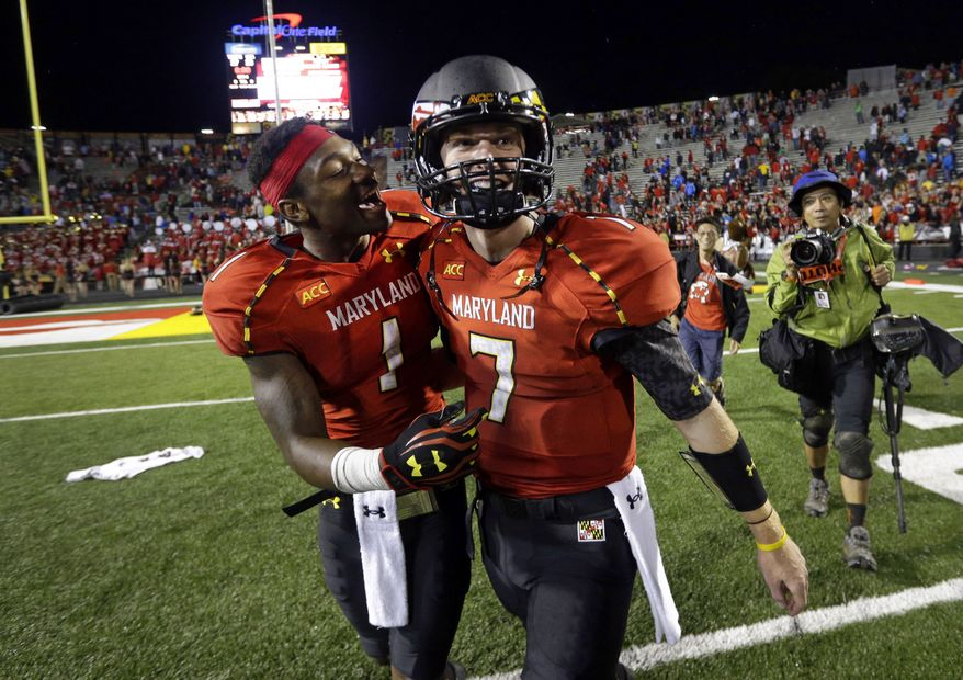 Maryland wide receiver Stefon Diggs (1) celebrates with quarterback Caleb Rowe after the team's 27-26 win over Virginia in an NCAA college football game in College Park, Md., Saturday, Oct. 12, 2013. (AP Photo/Patrick Semansky)