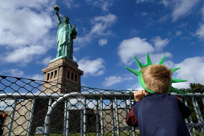 LIBERATED: Jackson Blendowski, 6, of New Hampshire is one of the first visitors since Oct. 1 to visit the Statue of Liberty. The national landmark reopened after the state o