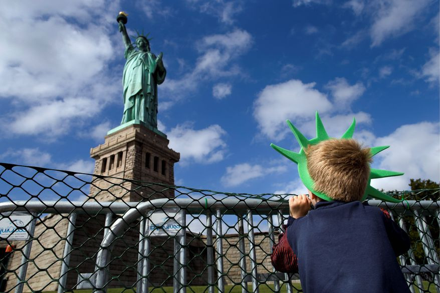 LIBERATED: Jackson Blendowski, 6, of New Hampshire is one of the first visitors since Oct. 1 to visit the Statue of Liberty. The national landmark reopened after the state of New York agreed to shoulder the costs of running the site during the federal shutdown. (Associated Press)
