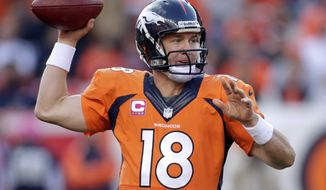 Denver Broncos quarterback Peyton Manning (18) throws a pass against the Jacksonville Jaguars in the fourth quarter of an NFL football game, Sunday, Oct. 13, 2013, in Denver. Denver won 35-19. (AP Photo/Joe Mahoney)