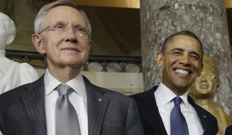 President Obama and Senate Majority Leader Harry Reid of Nevada smile for photographers on Capitol Hill in Washington after the unveiling of a statue of Rosa Parks in February 2013. (Associated Press) **FILE**