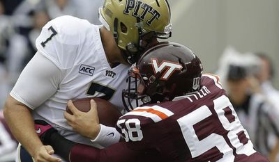 Pittsburgh quarterback Tom Savage (7) is sacked by Virginia Tech linebacker Jack Tyler (58) during the first half of an NCAA college football game in Blacksburg, Va., Saturday, Oct. 12, 2013.  (AP Photo/Steve Helber)